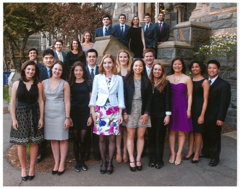 2012 Carroll Fellows, standing outside of Healy Hall, smiling for a formal photo.