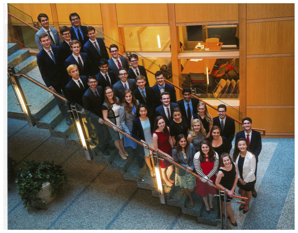 Carroll Fellow Class of 2016 standing in the MSB on a set of stairs, smiling at the photographer above them.